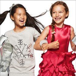 Motivos navideños y tejidos brillantes, en moda infantil, de la nueva campaña navideña 2014 de H&M